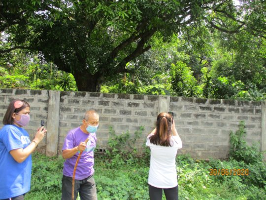 Ka Noli and others inspect the new wall