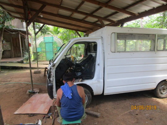 Bro Vic making repairs to the truck
