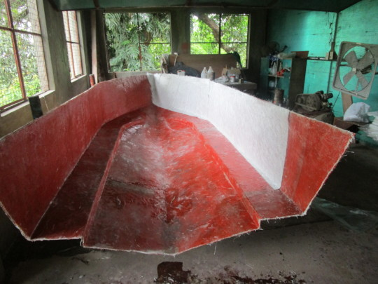 The first fibreglass layers laid in the mould