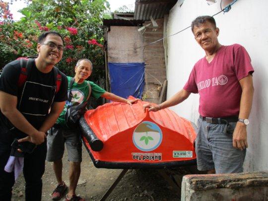 TJ, Ka Noli and a boat crew leader
