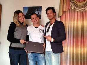 Mirzet, our scholarship studen receives his laptop