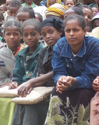 Girls attending mentoring session at their school