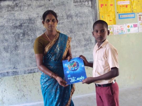 Student receiving atlas