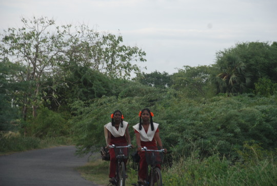 Students going to school using bi-cycle