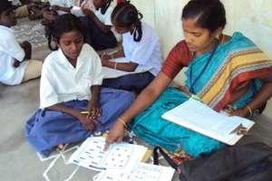 Para teacher teaching child