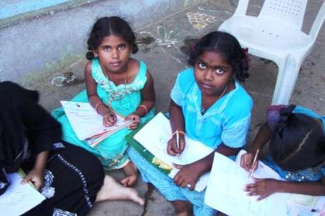 Coaching 100 school children in studies in India