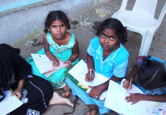 Coaching 100 school children in studies in India