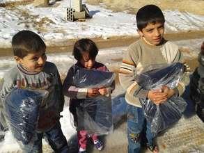 Syrian refugee children receive winter coats