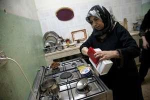 Um Samer prepares breakfast for her large family