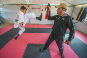 A Syrian boy practices Taekwondo