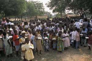 A section of children receiving christmas meals