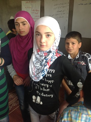 Young Syrian refugee in her classroom
