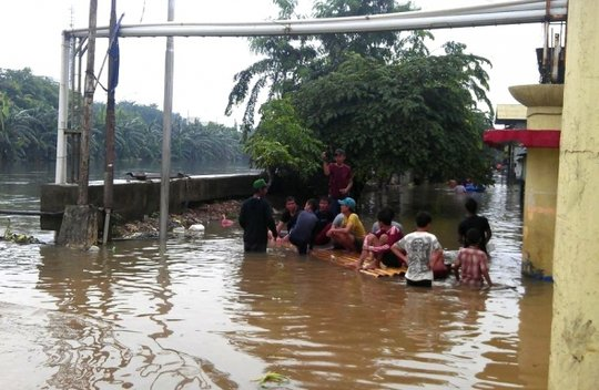 Massive Floods Displace Indonesian Families