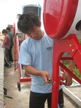 Mr Chiang Kaw working on the solar collectors