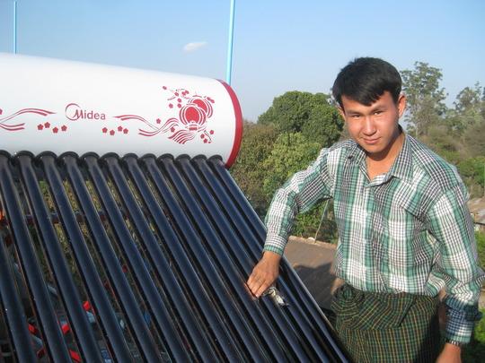 Mr Tu Mai cleaning the evacuated tubes