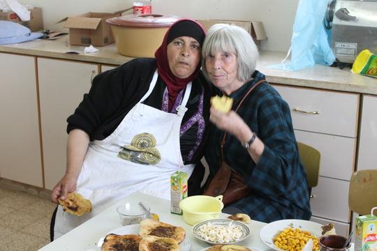 Barbara Lubin and Um Hassan eating breakfast