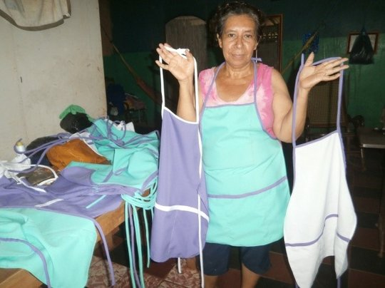 Adelina displays her aprons