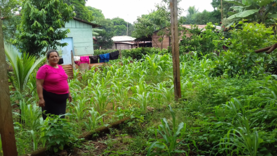 Adriana standing in her garden at her home