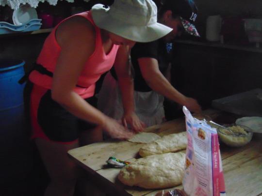 Bernarda teaching Kortney how to bake bread