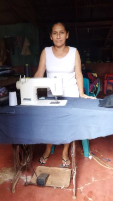 Yessenia with her sewing machine.