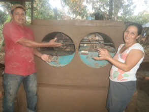 Magdalena & husband with their new oven in March