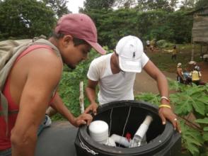 Jairo installing the new CTI-8 system in the tank