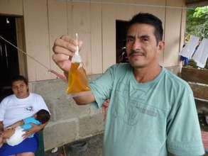 Miguel holds up contaminated crude water in 2013