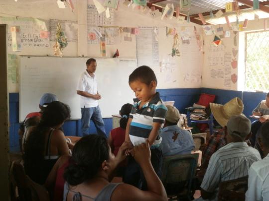 Child at Caracito community meeting