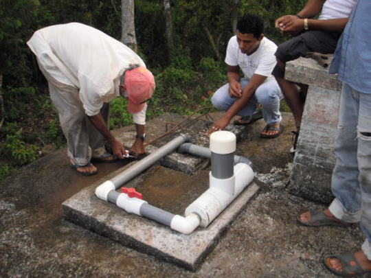 Installing a chlorinator in a water system.