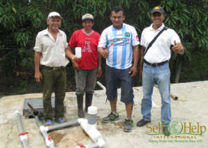 Walter Acevedo CAPS Leaders with new chlorinator