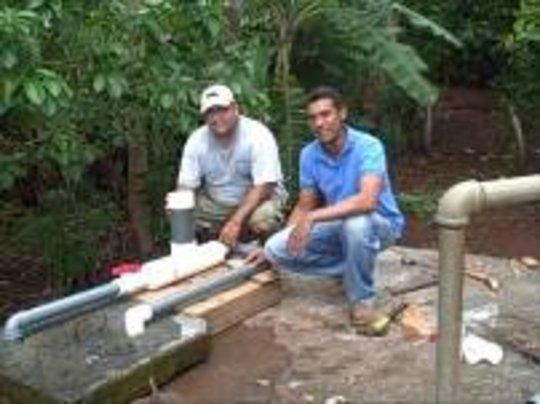 Walter and Orlando installing the Chlorinator