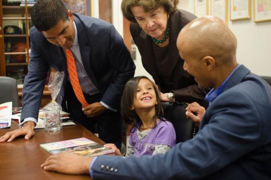 Sadin grins after Sen. Feinstein gave her a book