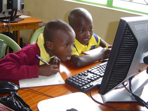 Students from Mbaikini PS in Exceed Academy class.