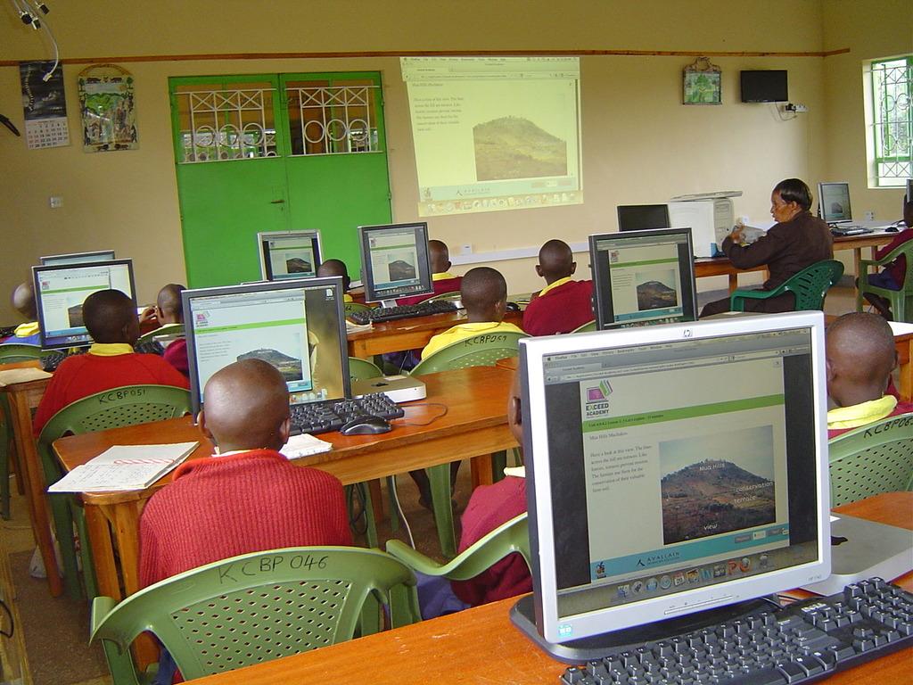 Mbaikini class exploring on photo slides