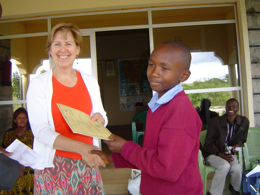 Well done! Jean cogratulates a student.