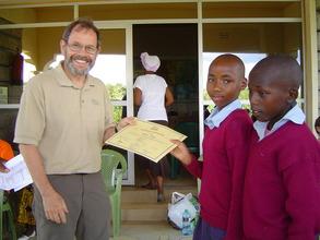 Good job! Steve congratulates a student