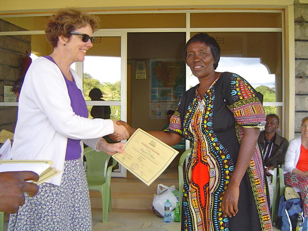 Keep up! Bath congratulates a teacher.