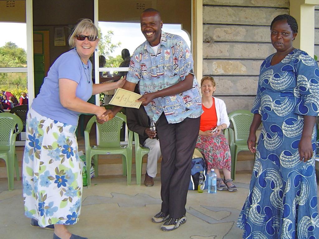 Sharon cogratulates the best teacher!