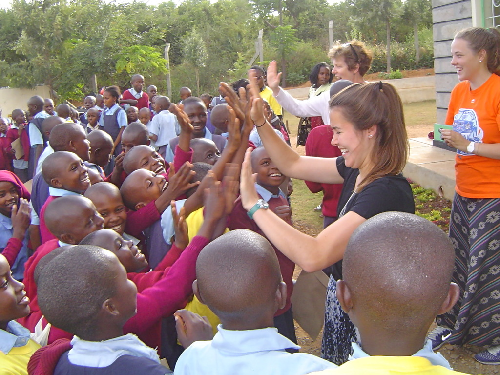 High five! Students celebrate their graduation!