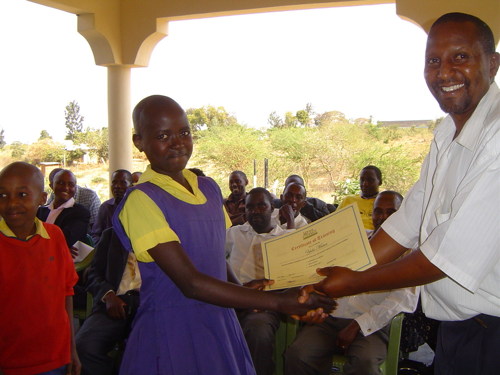 Well done! A student recieves a certificate