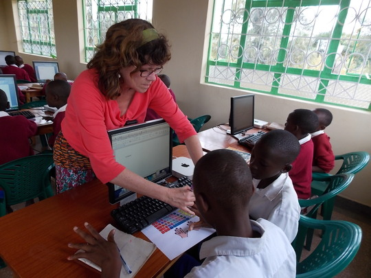 Laura Groo helps Kambiti students with keyboarding