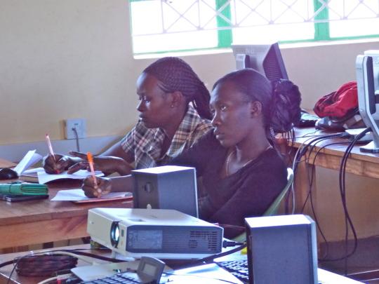Teachers listening to a webinar class at the LRC