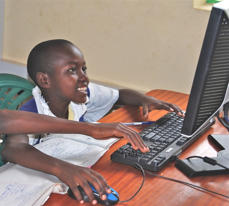 A student gets instruction on computer use at LRC