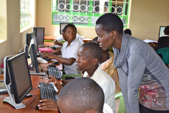 Irene working with students on computer skills