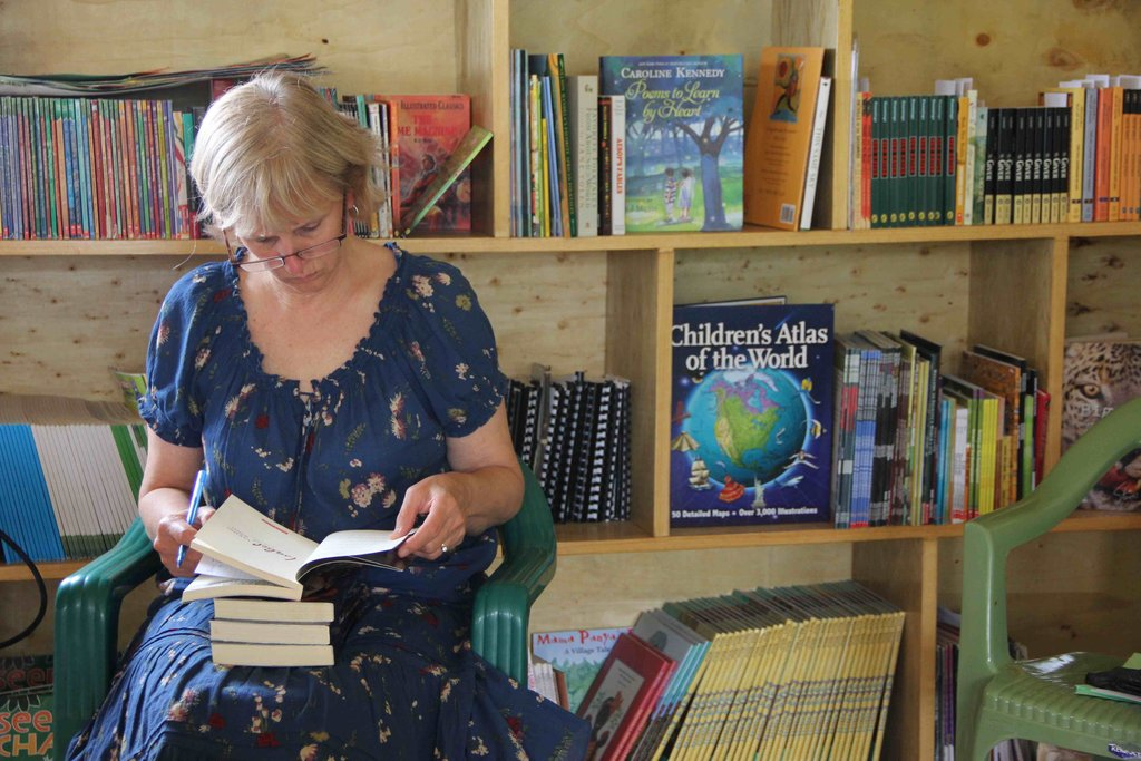 Theresa Vorce helps in  cataloguing the books