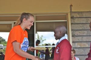 Kat congratulates at student