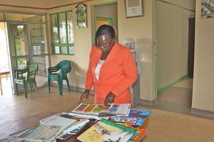 A teacher sampling new books at the LRC