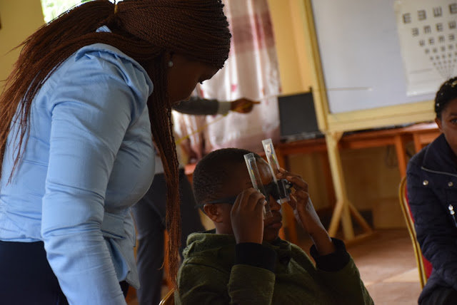 Esther assisting with Eye Screening