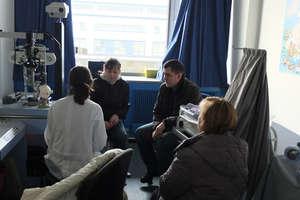 Katya's parents talking to a German doctor