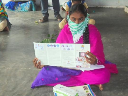 Student showing Corona Brochure